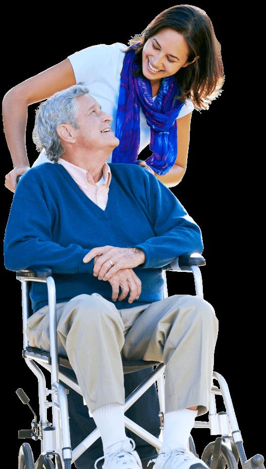 elder man sitting on a wheelchair with caregiver